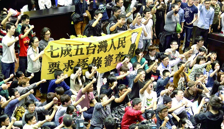 Protesters shout slogans inside Taiwan's legislature in Taipei